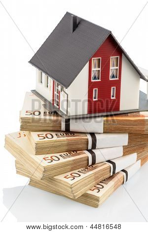 house on euro banknotes, symbolic photo for home purchase, financing, building society