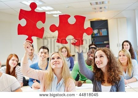 Students solving jigsaw puzzle as a team in university class