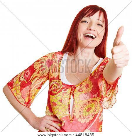 Happy best ager woman holding her thumbs up
