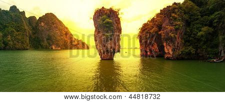 James Bond island sunset panoramic photography. Famous travel destination, Khao Phing Kan, Ko Tapu, Phang Nga Bay, Andaman Sea, Thailand. Exotic tropical nature landscape background