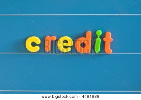 Credit written in children's magnetic letters. Concept to explain financial terms in simple ways poster