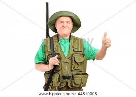 A male hunter with shotgun giving a thumb up isolated on white background