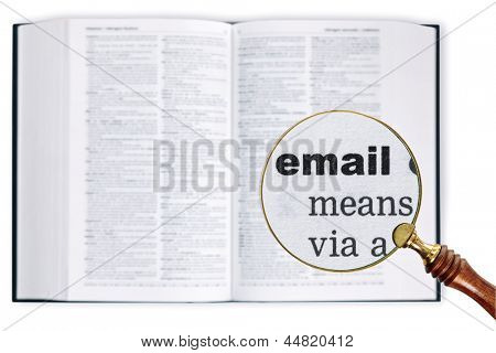 A magnifying glass held over a dictionary looking at the word Email enlarged