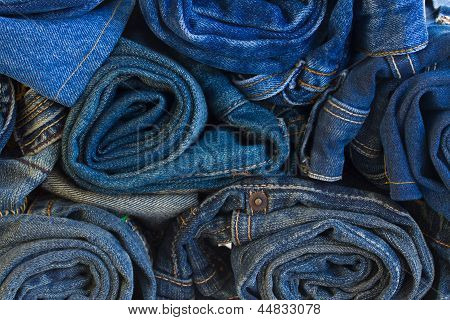 rols of jeans trousers