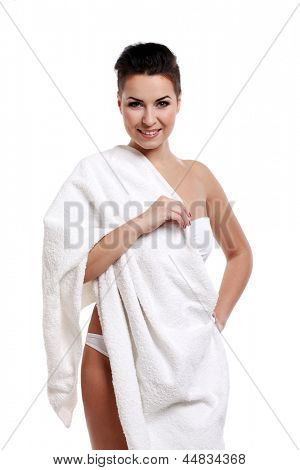 Young woman with short haircut in towel isolated over white background
