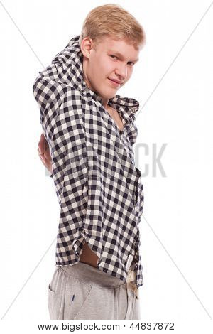 Portrait of young handsome guy excersising over grey background