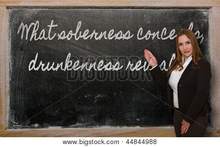 Teacher Showing What Soberness Conceals, Drunkenness Reveals On Blackboard