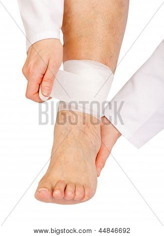 Applying a compression wrap for a sprained ankle poster