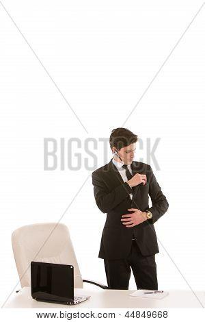 Businessman Putting Something In His Pocket