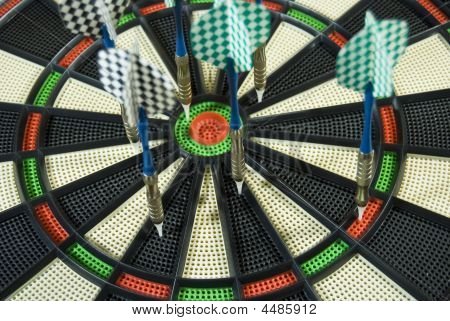 dart board in the bar with darts poster
