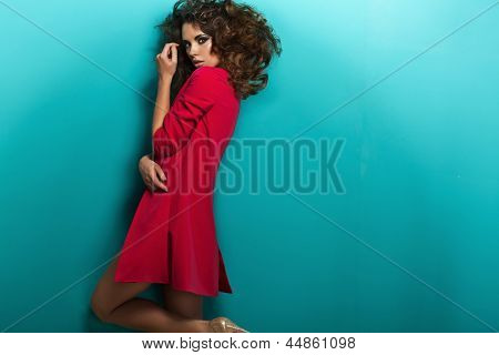 Fashion shot of a woman in pink coat