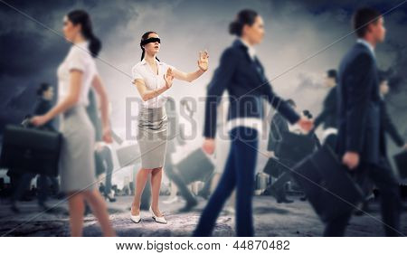 Image of businesswoman in blindfold walking among group of people poster