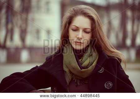 Cute Young Long-haired Woman Grieves