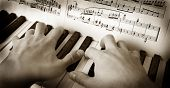 BW photo of piano playing - two hands. poster