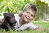 Portrait of little boy having good time in summer environment poster