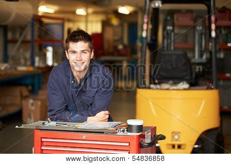 Portrait Of Apprentice Engineer In Factory