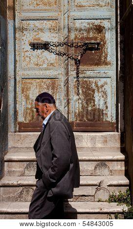 Muslim Man Passing Istanbul Doorway