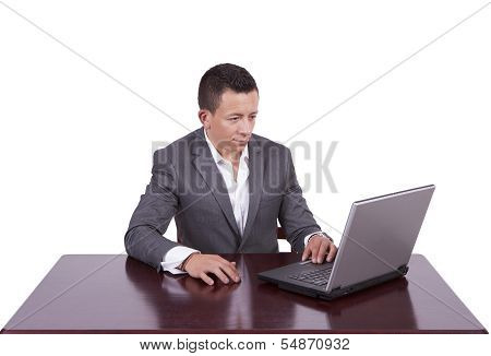 Handsome young businessman using laptop