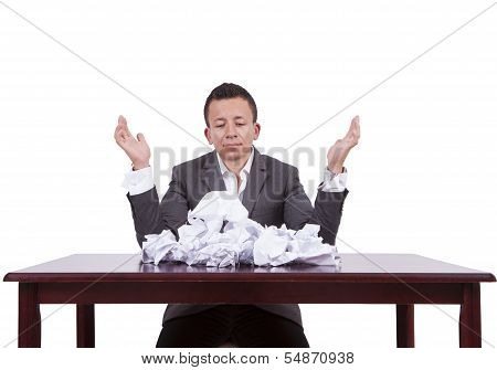 Businessman with crumpled papers on his desk
