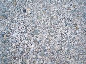 pebbles on the seashore as a background poster