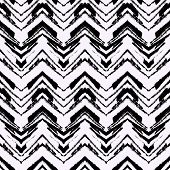 Black and white hand drawn pattern with zigzag lines. Vector seamless texture for web, print, home decor, textile, wrapping paper, wallpaper, invitation card background, summer fall fashion fabric poster