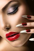 Fashion Beauty Model Girl. Manicure and Make-up. Nail art. Beautiful Woman With Red Nails and Luxury Makeup. Beautiful Girl Face and Hand close-up. Perfect Skin poster