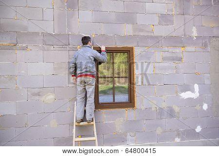 Man insulating windows