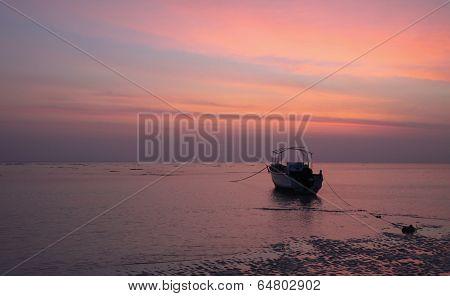 Orange Skies Grey Seas And A Lone Boat