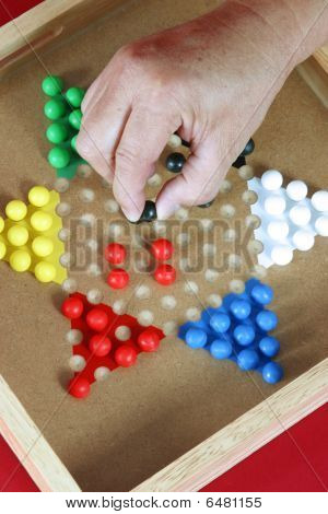 Hand moving Chinese checkers piece