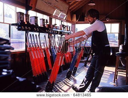 Man pulling levers in signal box, Bridnorth.