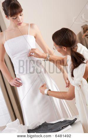 Fashion Model Fitting White Wedding Dress By Designer