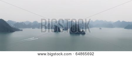 Halong Bay Vietnam panorama. Panoramic view of Ha Long bay sea, islands, mountains and misty horizon at morning.  Nature photography