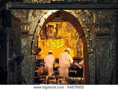 Mandalay, Myanmar - October 9: The Ritual Of Daily Face Washing Mahamuni Buddha