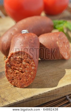 Turkish sausage sucuk on a cutting board poster