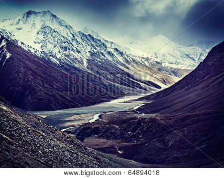 Vintage retro effect filtered hipster style travel image of severe mountains - Spiti valley, river, road in Himalayas. Himachal Pradesh, India