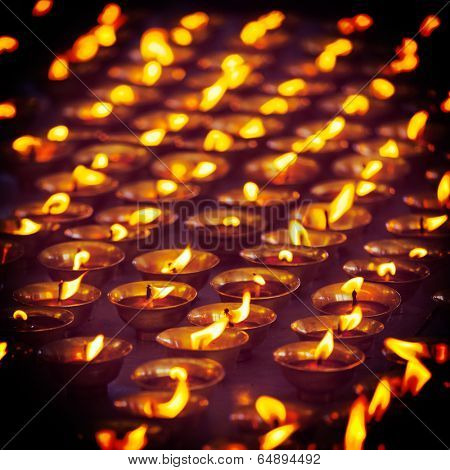 Vintage retro effect filtered hipster style travel image of burning candles in Buddhist temple. Tsuglagkhang complex,  McLeod Ganj, Himachal Pradesh, India