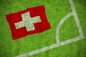 Switzerland national flag against corner of football pitch poster