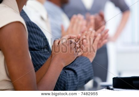 Ambitious Business Team Applauding In A Meeting