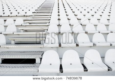 White Plastic Chairs In Rows