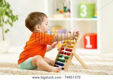 child boy playing with counter