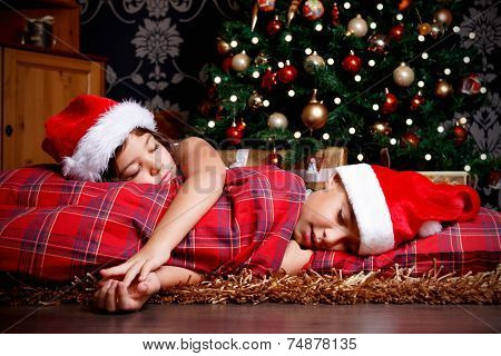 Little Siblings Asleep While Waiting For Gifts