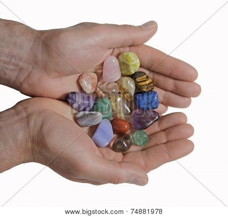 Male crystal healer offering selection