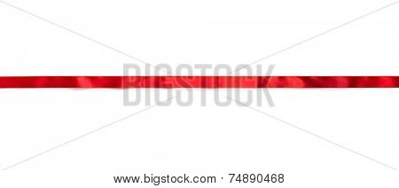 Extending simple red ribbon with typical ripples or wrinkles of a silky or satin ribbon , isolated on white.