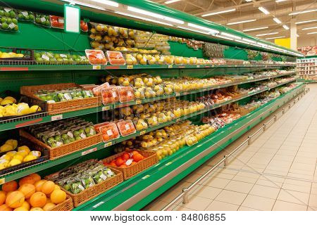 Shelf with citrus fruits, TMs removed, price tags left in place and contain no copyright poster