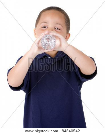 Happy latino boy drinking from water bottle on white background