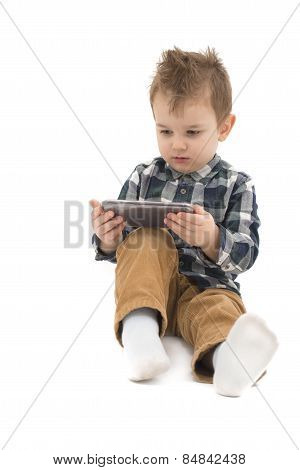 Little boy watching cartoons on cell phone