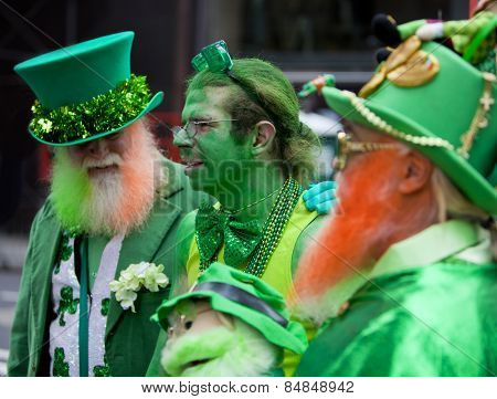 NEW YORK, NY, USA - MAR 16:  Three men in funny leprechaun costumes at the St. Patrick's Day Parade on March 16, 2013 in New York City, United States.