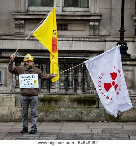 LONDON - DEC 21: An anti nuclear protester for the Fukushima Daiichi disaster stands outside the Japanese London embassy in the United Kingdom December 21, 2012 in London, England