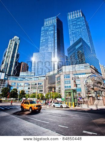 NEW YORK CITY - Aug 30: Sun reflecting off buildings at Columbus Circle, a major landmark and attraction in New York on August 30, 2012 in Manhattan, New York City.