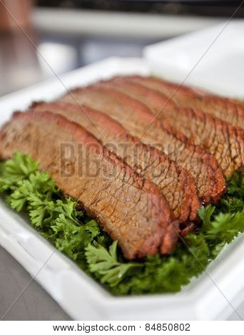 BBQ beef brisket on a bed of parsley
